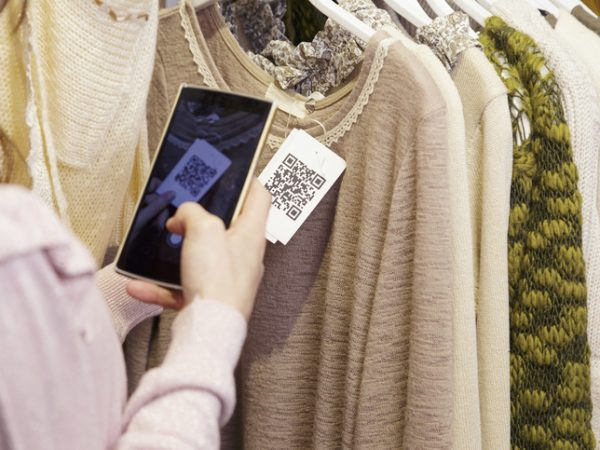 Woman scanning a QR code from a label.
