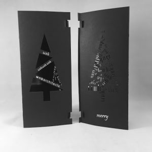 WNB Architects' tri-folded Holiday Cards that are foil stamped, laser cut, and printed on black paper with white toner.