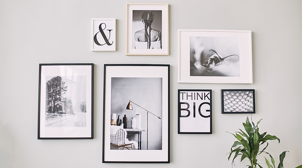 different-size-framed-photos-hanging-on-the-gray-wall