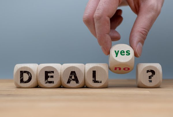 "Deal or no deal? Hand turns a cube and changes the word ""no"" to ""yes""."