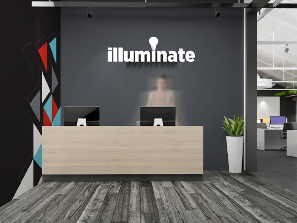 Illuminate logo behind a desk