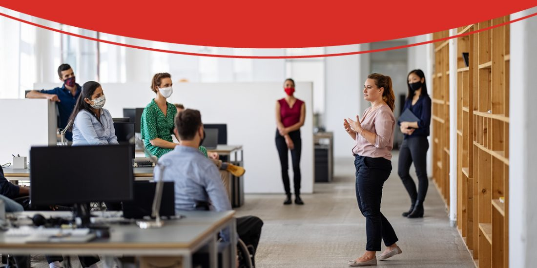 People with masks social distancing in an office setting